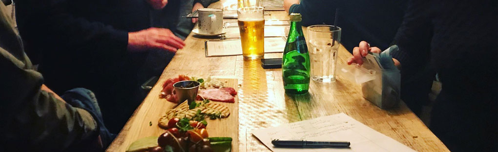 Food and drink on a table at the Creative Kick meetup